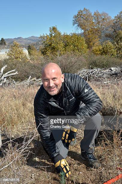Eddie Bauer President and CEO Mike Egeck poses with the 50 millionth Tree planted in celebration of 20Year partnership with American Forests on...