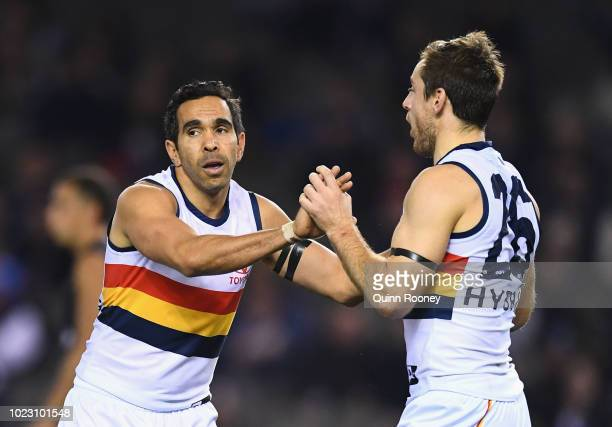 Eddie Betts and Richard Douglas of the Crows celebrate a goal during the round 23 AFL match between the Carlton Blues and the Adelaide Crows at...