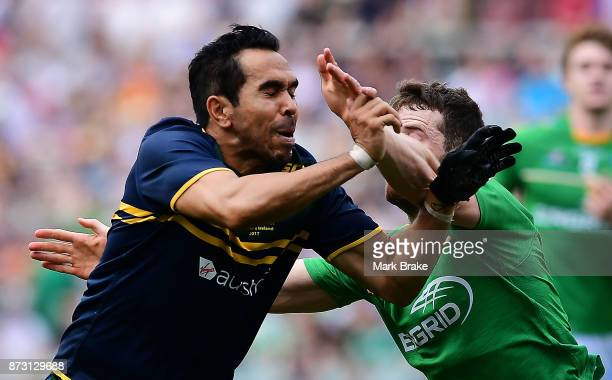 Eddie Betts of Australia gets caught during game one of the International Rules Series between Australia and Ireland at Adelaide Oval on November 12...
