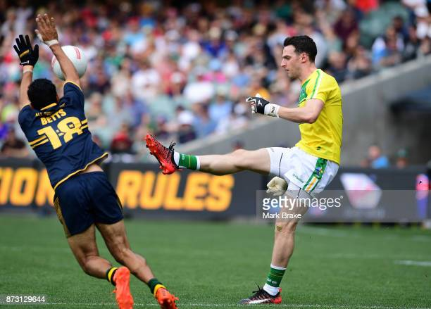 Eddie Betts of Australia trys to smother Niall Morgan kick out during game one of the International Rules Series between Australia and Ireland at...