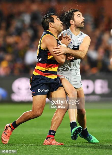 Eddie Betts of the Adelaide Crows and Kade Simpson of the Blues during the round seven AFL match between the Adelaide Crows and the Carlton Blues at...