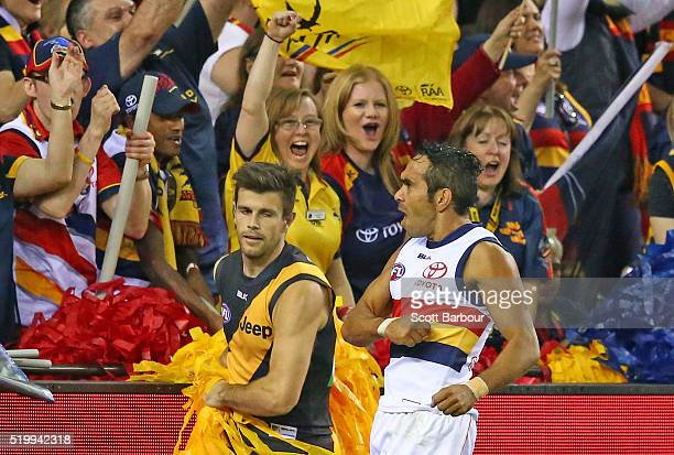 Eddie Betts of the Adelaide Crows celebrates after kicking a goal as Trent Cotchin of the Richmond Tigers looks on during the round three AFL match...