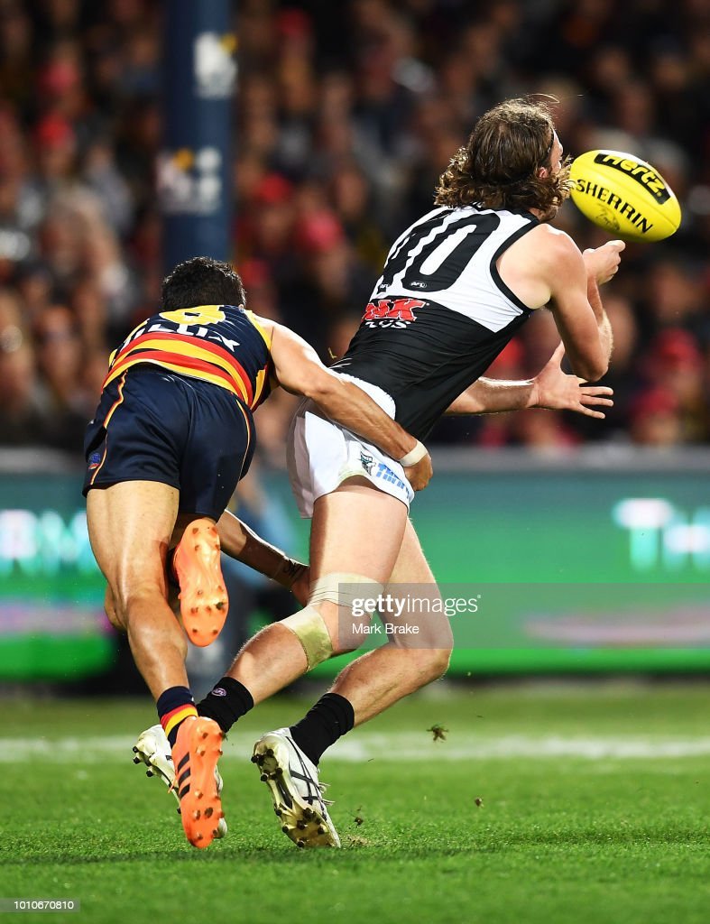Eddie Betts of the Adelaide Crows chases down Jarrod Lienert of Port Adelaide during the round 20 AFL match between the Adelaide Crows and the Port Adelaide Power at Adelaide Oval on August 4, 2018 in Adelaide, Australia.