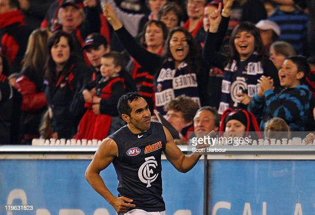 Eddie Betts of the Blues gestures after kicking a goal during the round 18 AFL match between Essendon Bombers and the Carlton Blues at Melbourne...