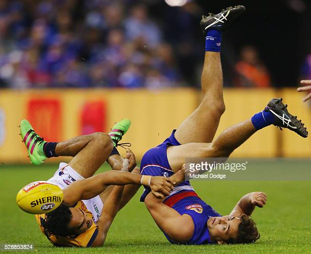 Eddie Betts of the Crows and Luke Dahlhaus of the Bulldogs compete for the ball during the round seven AFL match between the Western Bulldogs and the...