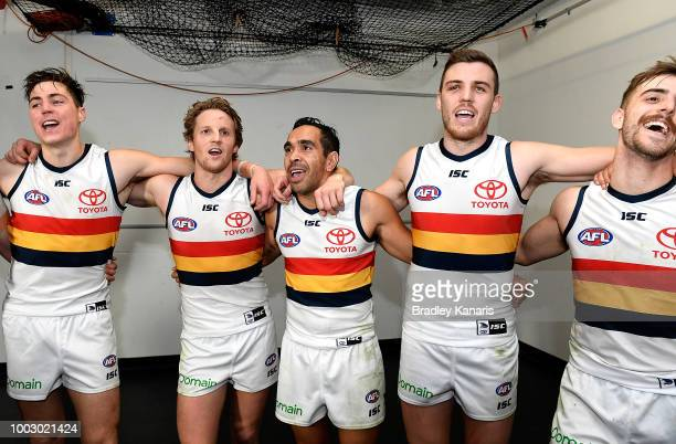 Eddie Betts of the Crows and team mates celebrate victory after the round 18 AFL match between the Brisbane Lions and the Adelaide Crows at The Gabba...