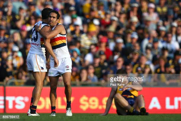Eddie Betts of the Crows celebrates a goal with Charlie Cameron during the round 23 AFL match between the West Coast Eagles and the Adelaide Crows at...
