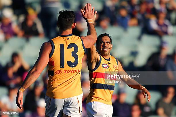 Eddie Betts of the Crows celebrates his sixth goal with Taylor Walker during the round 21 AFL match between the Fremantle Dockers and the Adelaide...