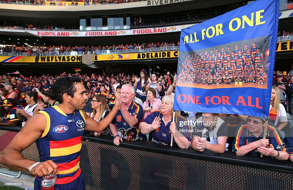 Eddie Betts of the Crows celebrates the win with fans during the round one AFL match between the Adelaide Crows and the North Melbourne Kangaroos at Adelaide Oval on April 5, 2015 in Adelaide, Australia.
