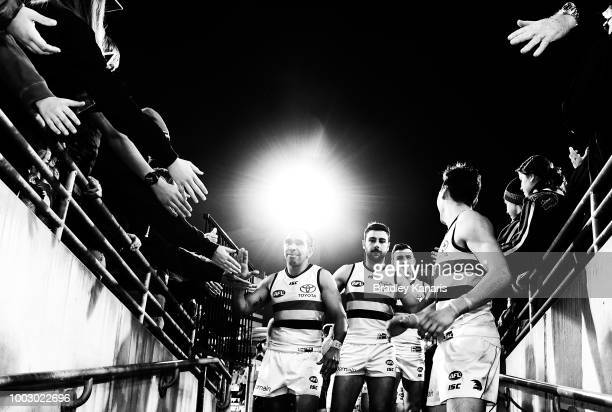 Eddie Betts of the Crows celebrates victory with the fans after the round 18 AFL match between the Brisbane Lions and the Adelaide Crows at The Gabba...