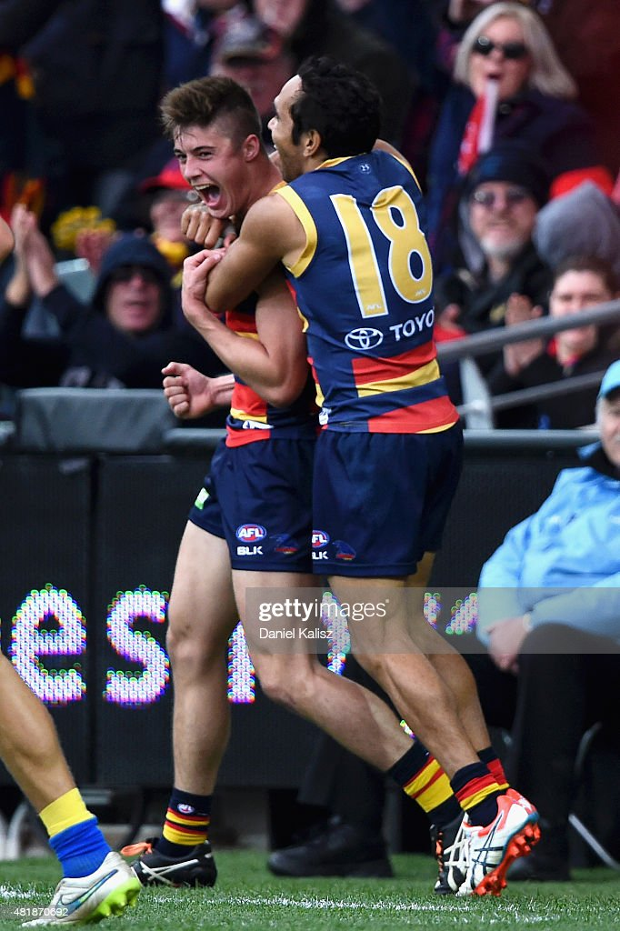 Eddie Betts of the Crows celebrates with Brodie Martin of the Crows after he scores a goal during the round 17 AFL match between the Adelaide Crows and the GOld COast Titans at Adelaide Oval on July 25, 2015 in Adelaide, Australia.