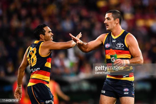 Eddie Betts of the Crows celebrates with Taylor Walker of the Crows during the round 5 AFL match between Adelaide and the Gold Coast at Adelaide Oval...