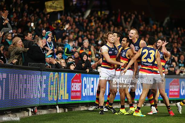 Eddie Betts of the Crows celebrates with teammates after he kicked a goal during the round 22 AFL match between the Port Adelaide Power and the...
