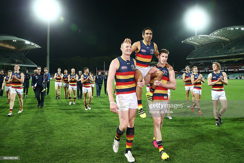 Eddie Betts of the Crows is chaired from the field by Sam Jacobs and Josh Jenkins after playing in his 250th AFL game during the round 22 AFL match between the Port Adelaide Power and the Adelaide Crows at Adelaide Oval on August 20, 2016 in Adelaide, Australia.