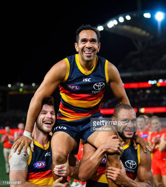 Eddie Betts of the Crows is chaired from the ground by Bryce Gibbs of the Crows and Cam EllisYolmen of the Crows after playing his 300th AFL game...