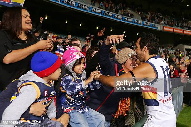 Eddie Betts of the Crows is congratulated by fans after defeating the Eagles during the round 12 AFL match between the West Coast Eagles and the...