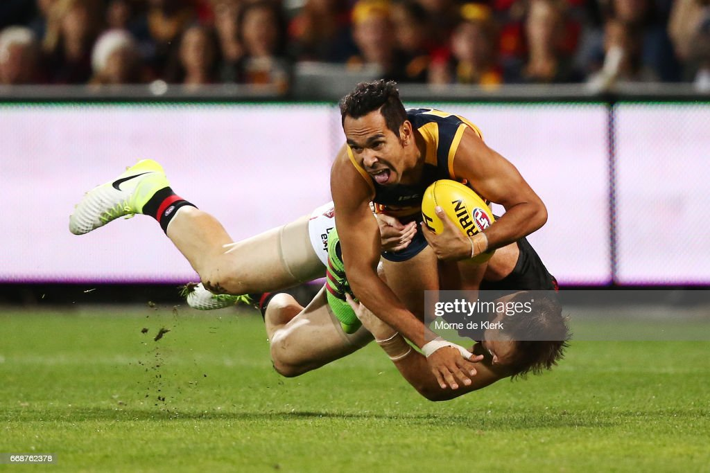 Eddie Betts of the Crows is tackled by Brendon Goddard of the Bombers during the round four AFL match between the Adelaide Crows and the Essendon Bombers at Adelaide Oval on April 15, 2017 in Adelaide, Australia.