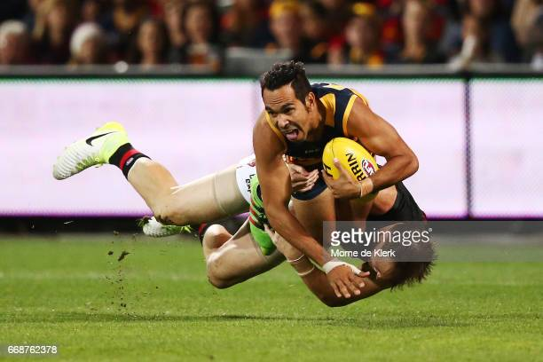 Eddie Betts of the Crows is tackled by Brendon Goddard of the Bombers during the round four AFL match between the Adelaide Crows and the Essendon...