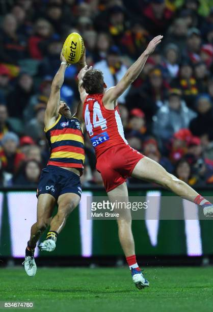 Eddie Betts of the Crows marks behind Jake Lloyd of the Swans competes during the round 22 AFL match between the Adelaide Crows and the Sydney Swans...