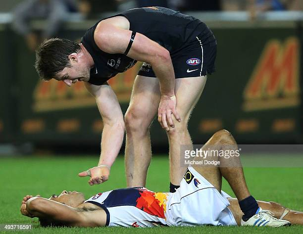 Eddie Betts of the Crows reacts next to Sam Rowe of the Blues on the final siren after losing during the round 10 AFL match between the Carlton Blues...