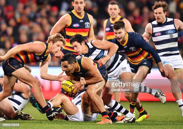 Eddie Betts of the Crows runs with the ball during the round 17 AFL match between the Adelaide Crows and the Geelong Cats at Adelaide Oval on July 12...