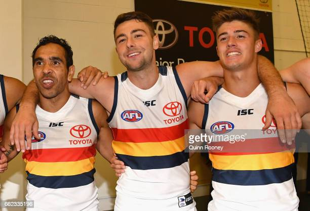 Eddie Betts Rory Atkins and Riley Knight of the Crows sing the song after winning the round two AFL match between the Hawthorn Hawks and the Adelaide...