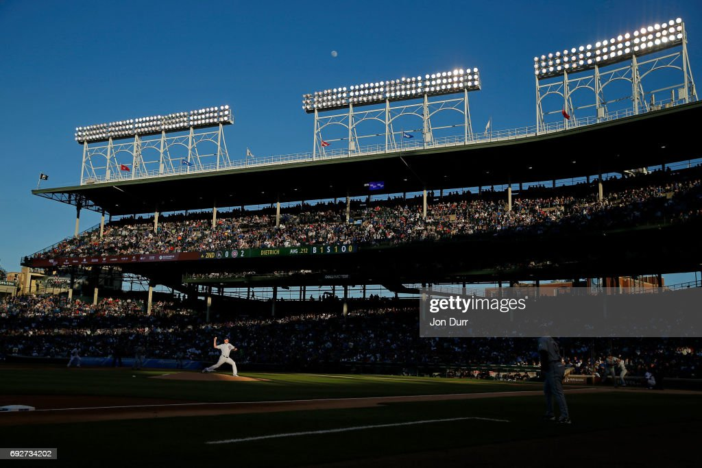 Eddie Butler #33 of the Chicago Cubs pitches against Derek Dietrich #32 of the Miami Marlins during the second inning as the moon begins to rise above Wrigley Field on June 5, 2017 in Chicago, Illinois.