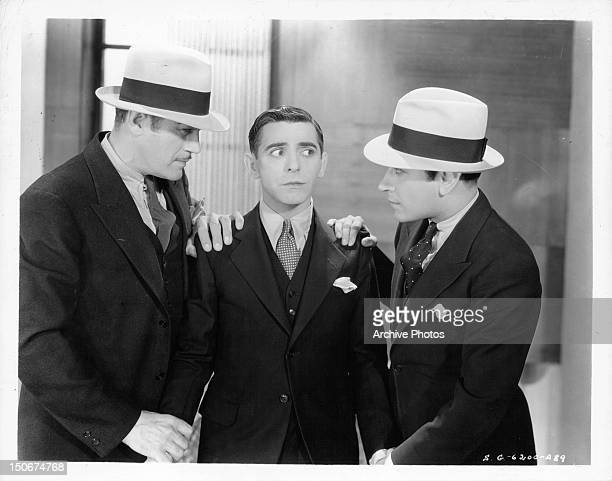 Eddie Cantor is grabbed by George Raft and another man in a scene from the film 'Palmy Days' 1931