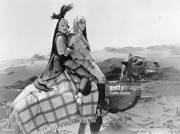 Eddie Cantor riding on a camel through the desert in a scene from the film 'Kid Millions' with Ethel Merman the American star entertainer The film...