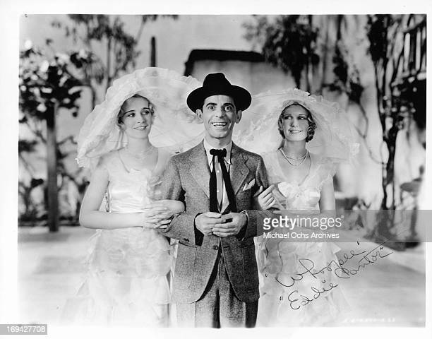 Eddie Cantor side by side with two other women in a scene from the film 'Whoopee' 1930