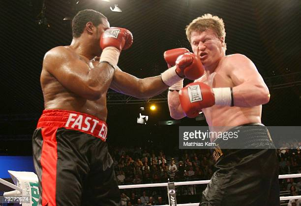 Eddie Chambers of the U.S. Punches Alexander Povetkin of Russia during their IBF final eliminator heavyweight match at the Tempodrom on January 26,...