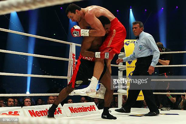 Eddie Chambers of USA lifts up Wladimir Klitschko of Ukraine during their WBO Heavyweight World Championship fight at the Esprit Arena on March 20...