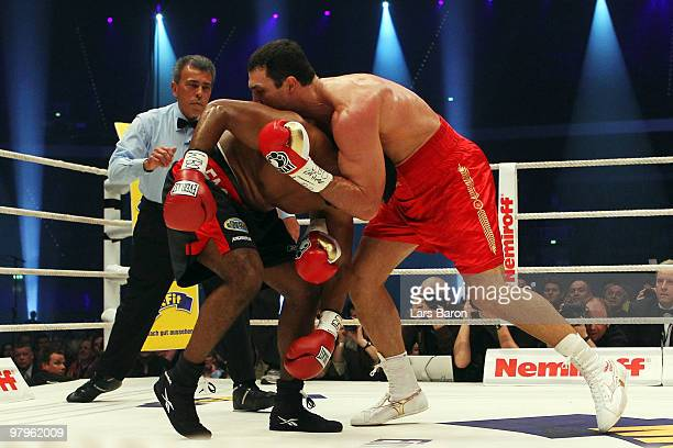 Eddie Chambers of USA pushes Wladimir Klitschko of Ukraine during their WBO Heavyweight World Championship fight at the Esprit Arena on March 20 2010...