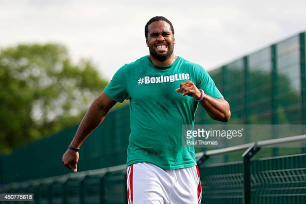 Eddie Chambers reacts during the Tyson Fury Media Session at the Eddie Davies Football Academy on June 17 2014 in Bolton England