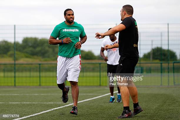 Eddie Chambers warms up during the Tyson Fury Media Session at the Eddie Davies Football Academy on June 17 2014 in Bolton England