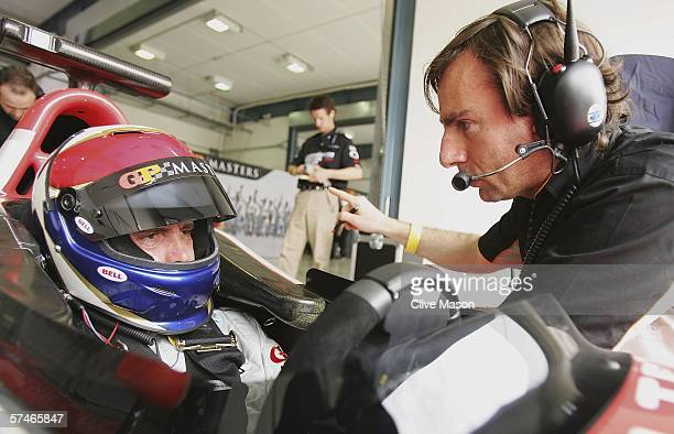 Eddie Cheever of the USA talks to his engineer during second practice prior to the Grand Prix Masters race at the Losail International Circuit on...