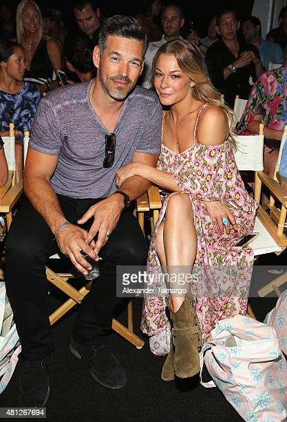 Eddie Cibrian and LeAnn Rimes attend the Tori Praver fashion show during FUNKSHION Fashion Week Miami Beach Swim at the FUNKSHION Tent on July 18...