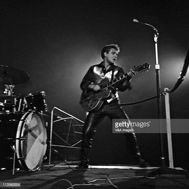 Eddie Cochran performs on stage playing a Gretsch G6120 Chet Atkins guitar and wearing leather trousers at The NME Poll Winners' Party concert...