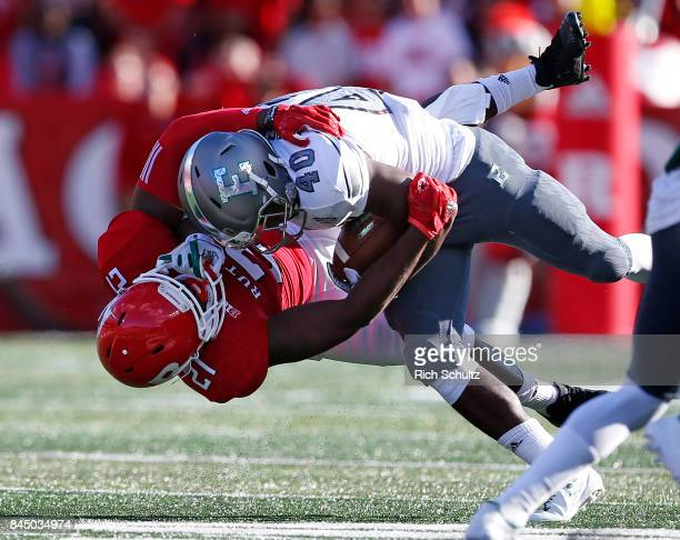 Eddie Daugherty of the Eastern Michigan Eagles is tackled by Ross Douglas of the Rutgers Scarlet Knights during the second quarter of a game on...