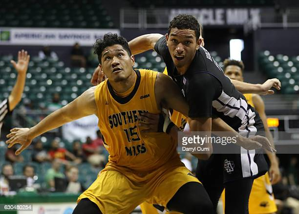 Eddie Davis III of the Southern Mississippi Golden Eagles and TJ Holyfield of the Stephen F Austin Lumberjacks jockey for position during the second...