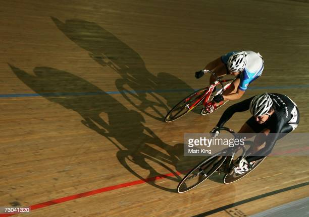 Eddie Dawkins of New Zealand and Tomohiro Kukaya of Japan fight it out in the Men's Sprint semi-final during the Track Cycling event of the...