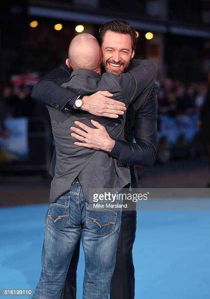 Eddie Edwards and Hugh Jackman arrive for the European premiere of 'Eddie The Eagle' at Odeon Leicester Square on March 17 2016 in London England
