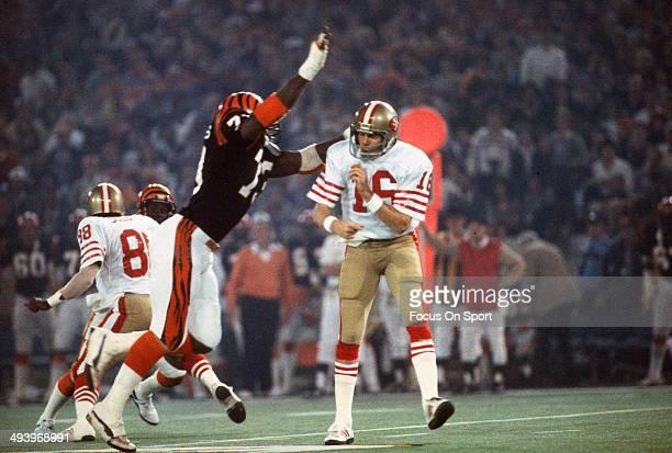 Eddie Edwards of the Cincinnati Bengals puts the pressure on quarterback Joe Montana of the San Francisco 49ers during Super Bowl XVI on January 24...