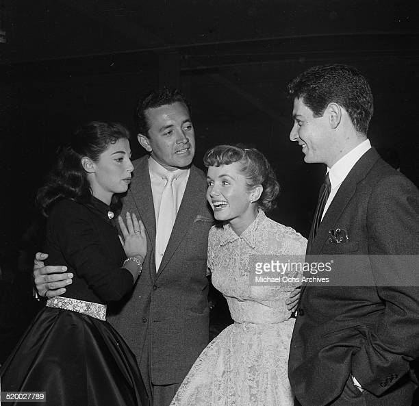 Eddie Fisher and Debbie Reynolds pose with Pier Angeli and Vic Damone during their party at Cantors in Los AngelesCA