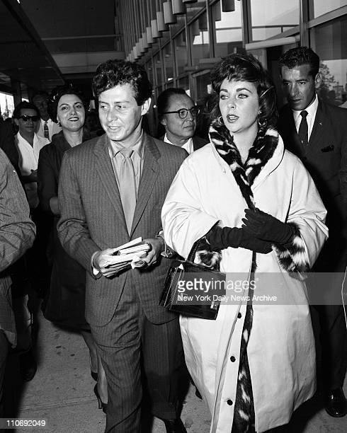Eddie Fisher and Elizabeth Taylor arrive at International Airport and head for the Drake Hotel