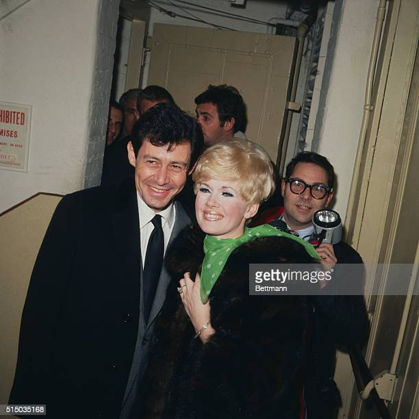 Eddie Fisher with his fiancee Connie Stevens backstage at the Plymouth Theatre where she is starring in the show The Star Spangled Girl They will...