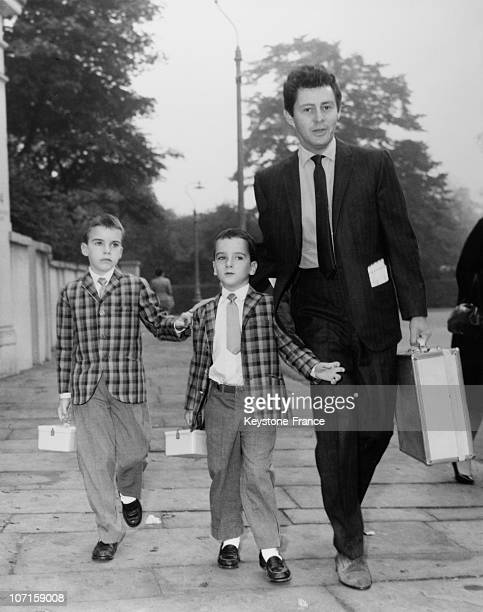 Eddie Fisherthe second husband of Elizabeth Taylor with both son of Liz Taylor out for the American High School on September 19 1960 in London England