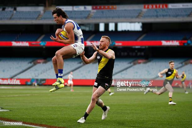 Eddie Ford of the Kangaroos marks the ball during the round 21 AFL match between Richmond Tigers and North Melbourne Kangaroos at Melbourne Cricket...