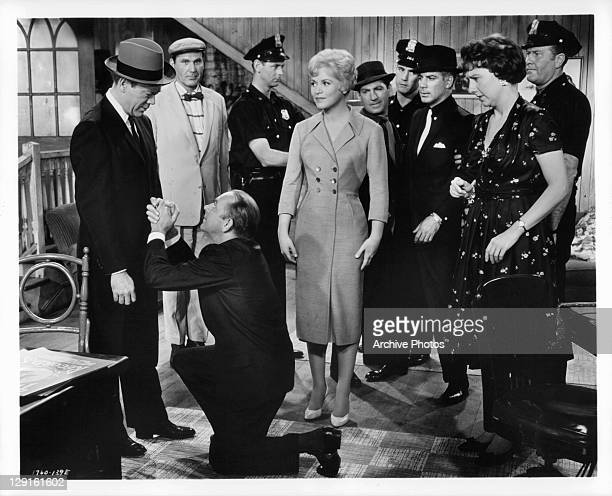 Eddie Foy Jr discovers that crime doesn't pay as he down on his knees in front of Dort Clarke Ralph Roberts Judy Holliday and Jean Stapelton watch in...