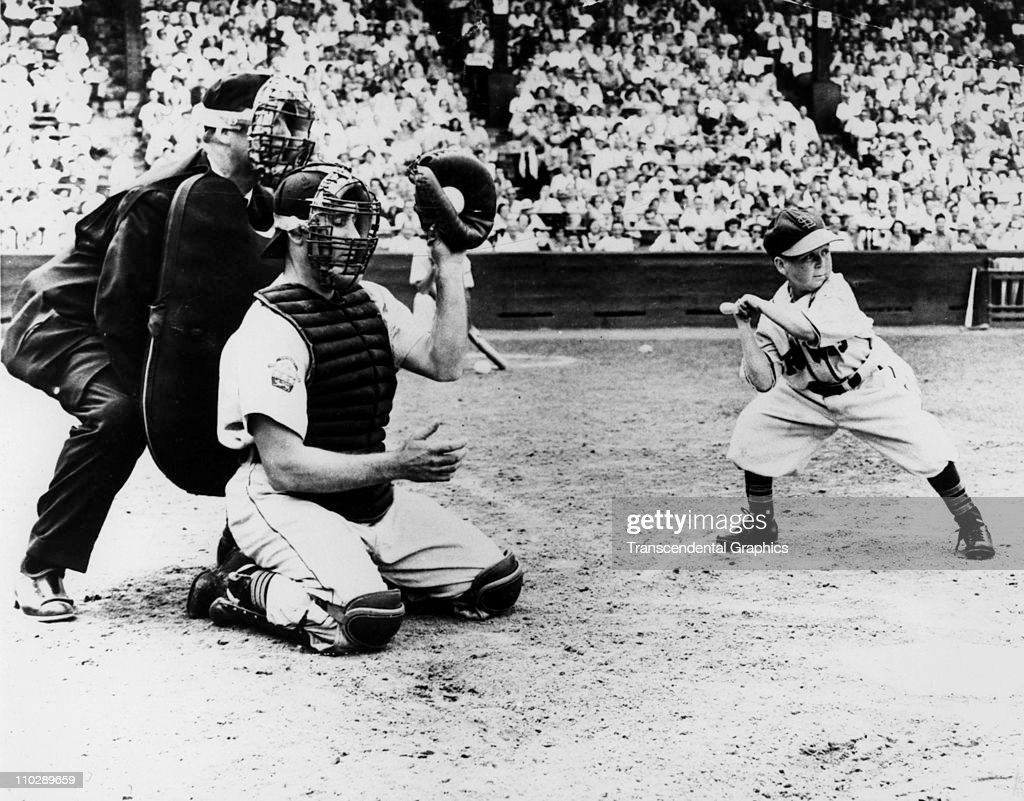 Eddie Gaedel, midget hired by St. Louis Browns owner Bill Veeck, takes a ball as he bats during a game on August 18, 1951 in St. Louis, Missouri.